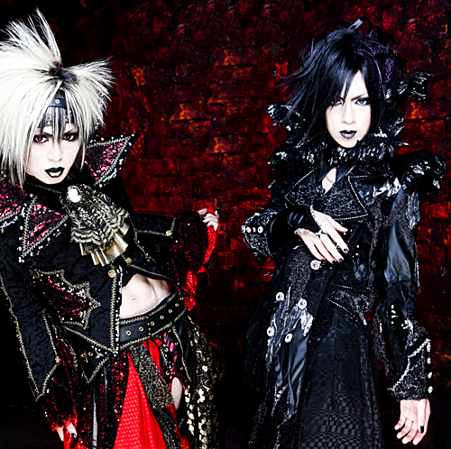 What was the name of the band Yo-ka, Kei and Yuu were in prior to DIAURA?