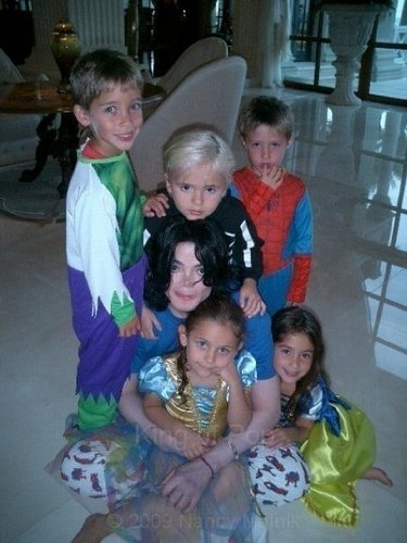 prince and paris with their daddy and friends