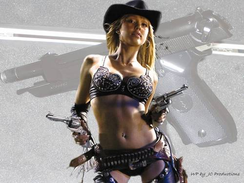 Jessica Alba with her six shooters from Sin City