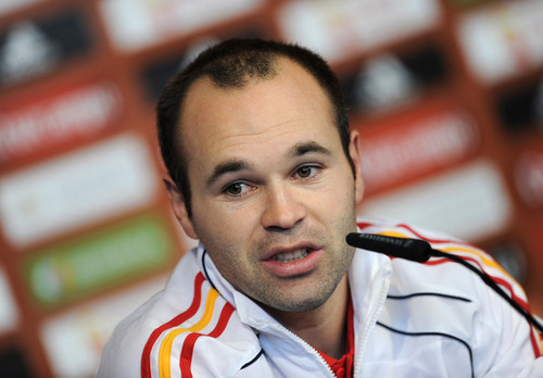 A. Iniesta playing for Spain