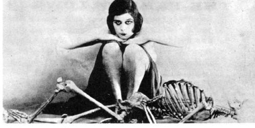 Theda Bara with skeleton