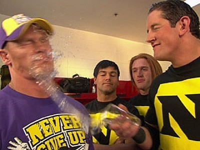WADE throwing water in Cena's face