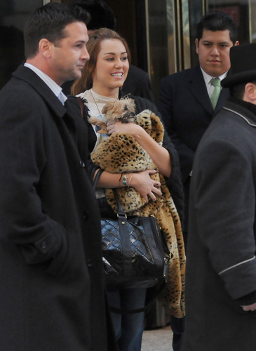 Miley cyrus leaving her hotel in New York City.