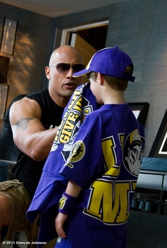The Rock with little Cena