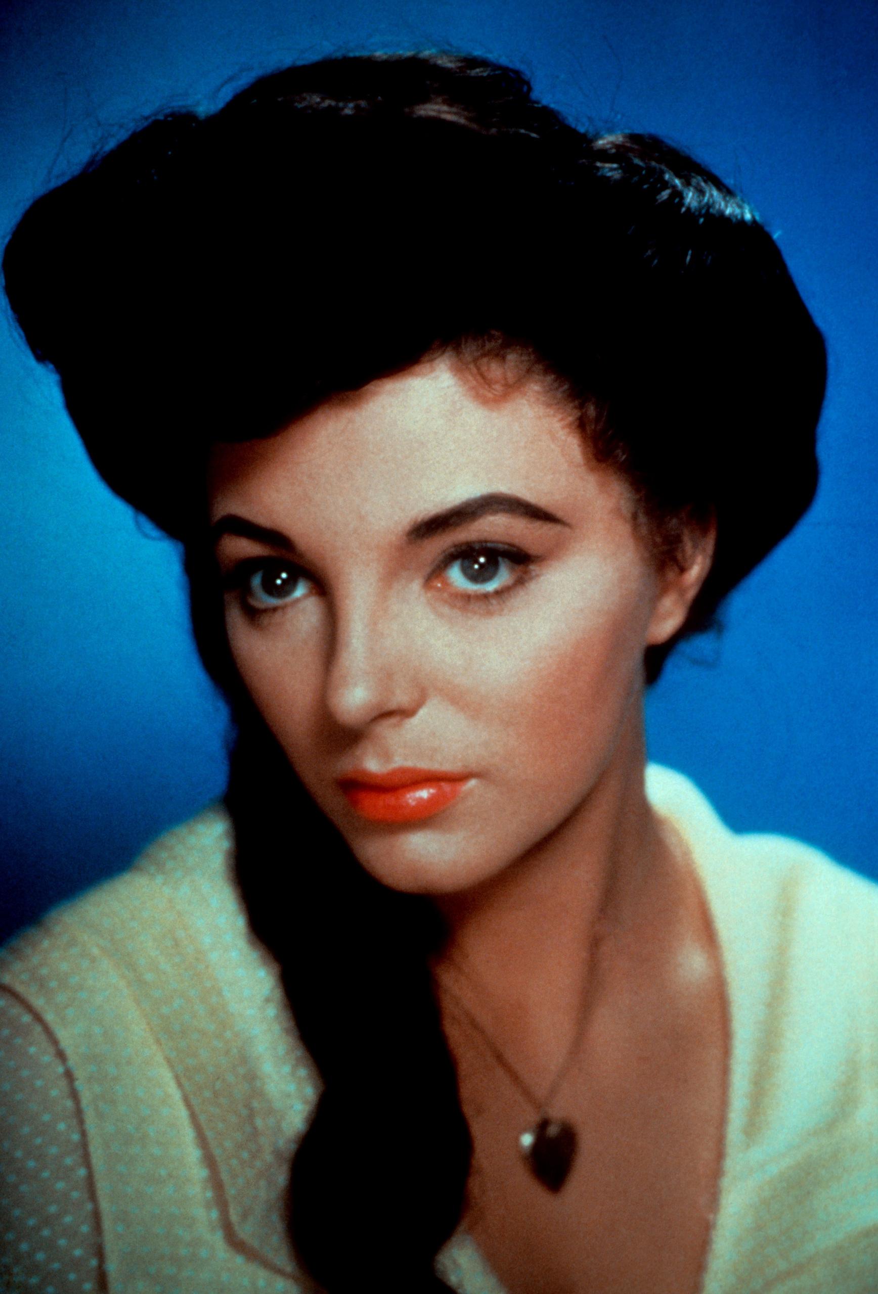 http://images4.fanpop.com/image/photos/21000000/Joan-Collins-joan-collins-21098226-1736-2560.jpg