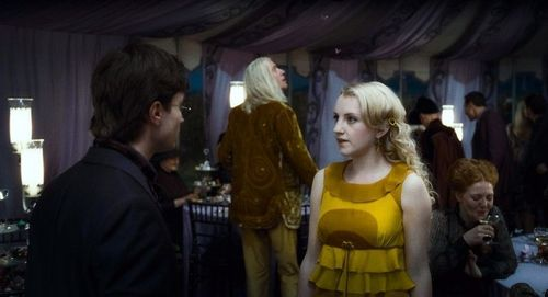 Luna Lovegood with Harry Potter at wedding