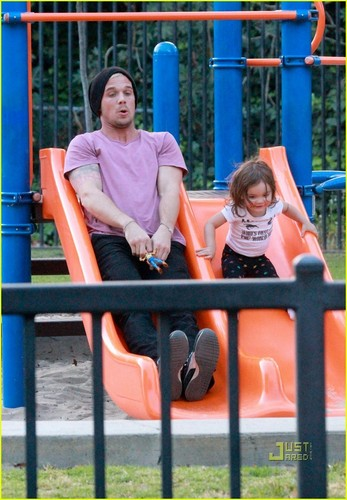 Cam with his daughter on playground in LA