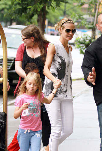 Heidi Klum seen arriving at her Downtown NYC hotel with her children, mother, and nanny.
