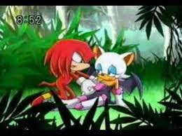 Knuckles helps Rouge