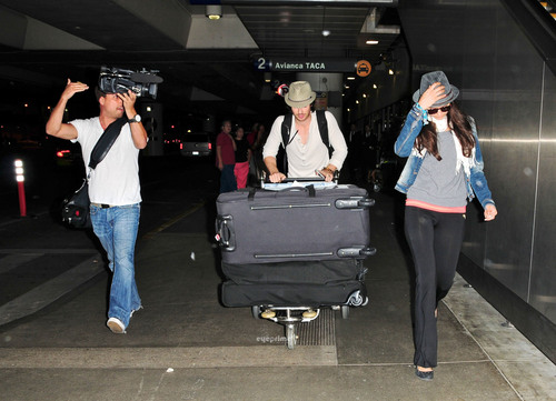 Nina Dobrev & Ian Somerhalder land at LAX, Jul 5