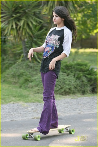 Selena Gomez looks like buttercup SKATEBOARDER WITH GREEN SKATEBOARD?!?!