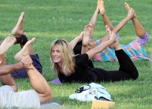 July 12: Doing yoga with Russell Simmons