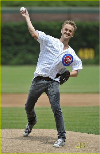 Tom Felton throws out the first pitch of the Chicago Cubs and Houston Astros game held at Wrigley
