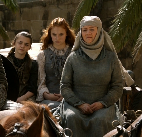 Arya and Sansa Stark with Septa